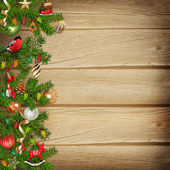 Christmas miraculous garland on a wooden background — Stock Photo