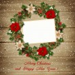Christmas wreath with frame on wooden background — Stock Photo #36209557