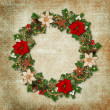Vintage shabby background with a wreath of pine branches and Christmas decorations — Foto de Stock