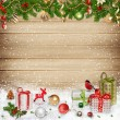 Christmas decorations and gifts on a wooden background — Stock Photo