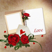 Red roses, notepad, frame on vintage background — Stock Photo