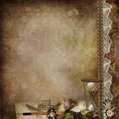 Vintage shabby background with faded roses, hourglass and retro decor — Stock Photo