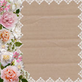 Border of roses and lace on a cardboard background — Zdjęcie stockowe