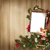 Frame with gorgeous Christmas decorations on wooden background — Stock Photo