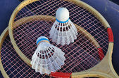 Badminton - two shuttlecocks on rackets — Stock Photo