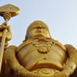 Stock Photo: Lord Murugstatue at hindu Batu caves on outskirts of