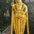 Lord Murugan statue at the hindu Batu caves on the outskirts of - Stock Photo