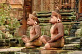 Gods sculptures at Banteay Srei, the temple of women, near Angko — Stock Photo