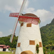Vintage windmil in Cha Am - Stock Photo