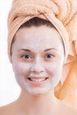 Beautiful girl's face with cream — Stock Photo