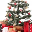 Stock Photo: Christmas Tree and Gifts. Over white background.