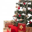 Christmas Tree and Gifts. Over white background. — Stock Photo #15315889