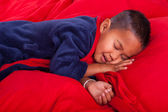 Sleeping boy in bed — Stock Photo