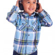 Asian little boy listening to music — Stock Photo