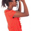 African American using binoculars isolated over white background - Stok fotoraf