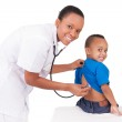 African american woman doctor with child — Stock Photo