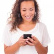 Happy woman texting on her phone — Stock Photo