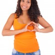 Young african american woman making a heart with hands — Stock Photo