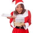 Young african american woman with  santa hat and gifts — Stock Photo