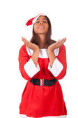 Young African American woman wearing a santa hat  — Stock Photo