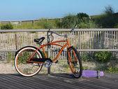 Orange Bike On Boardwalk — Stock Photo