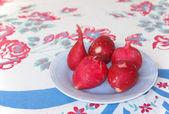 Radishes On Vintage Table Cloth — Stock Photo