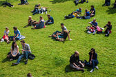 People enjoy a sunny day in a park in Gent — Stock Photo