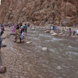 Unidentified local people bath in a canyon — Stock Photo