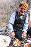 Old village man eats his lunch — Foto de Stock