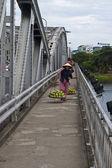 Street vendor on a bridge over Perfume River — Stock Photo
