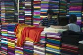 Fabric sellers in a big market in Hanoi — Stock Photo