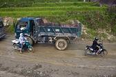Traffic on a muddy road — Stock Photo