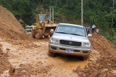 Bulldozer clears the road — Stock Photo