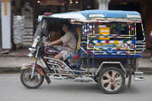 Driving tuk tuk in Luang Prabang — Stock Photo