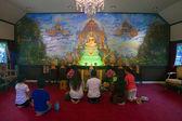 Believers pray in a Wat Saket Temple — Stock Photo