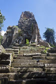 Ruins of ancient Angkor temple in a jungle — Stock Photo