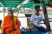 Boatman and monk on a ferry — Stock Photo