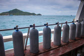 Cylinders aboard diving boat — Stock Photo