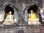 Row of buddha statues inside a temple — Stock Photo