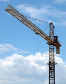 Industrial landscape with cranes on the blue sky — Stock Photo