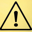 Hazard warning attention sign with exclamation mark symbol — Stock Photo