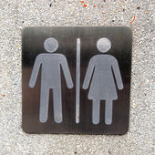 Toilet plate sign on wall — Stock Photo