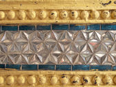 Thailand pattern on walls of buddhistic temple — Stock Photo