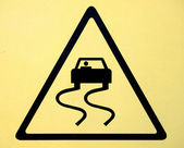 Slippery when wet road sign — Stock Photo