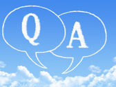 Question and answer marks with speech bubbles shaped cloud — Stock Photo