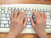 Hands on the PC keyboard — Stock Photo