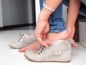 Female feet and shoes — Stock Photo