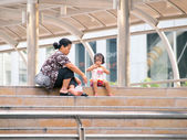 BANGKOK - MARCH 3 : people sitting on the skywalk , March 3, 2012 in Bangkok, Thailand. — Stock Photo