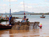 CHUMPHON THAILAND SEPTEMBER 22: Fisherman carrys net in his boat on 22 september 2012 in Chumphon Thailand. — Stock Photo