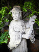 BANGKOK, THAILAND - January 4: Chinese Statue on 4 January 2012 at ancient buddhist Temple (Wat Pho), Bangkok, Thailand — Stockfoto